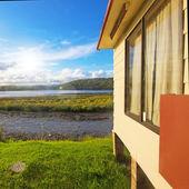 House at the lake bank — Stock Photo