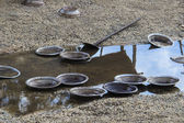 A prospector's pan left by the river. This is the pans that is u — Stock Photo