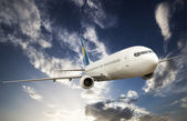 Big airplane in the sky — Stock Photo