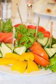 Peppers, tomatoes and cucumber on the plate. shallow depth of field — Stock Photo