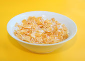 Healthy Breakfast-Cornflake on a yellow background — Stock Photo