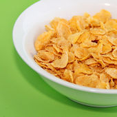 Healthy Breakfast-Cornflake on a green background — Stock Photo
