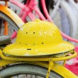 Indonesian bicycles for rent in Jakarta, yellow hat . Java, Indonesia. — Stock Photo