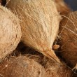 Organic coconuts at local market — Stock Photo