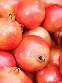 Close up of pomegranate on market stand — Stock Photo