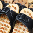 Wooden massage slippers at the market — Stock Photo