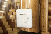 Modern electrical switch of country hut. — Stock Photo