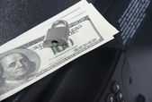 Dollars on a closed safe — Stock Photo