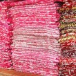 Stock Photo: Scarfs on shop counter, pile of colorful fabric . Shallow depth of field