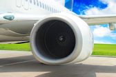 Turbine of passenger plane that waiting for departure in airport — Stock Photo