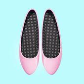 Розовые туфли на синем фоне — Стоковое фото
