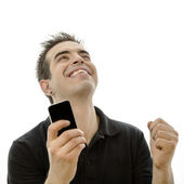 Happy young man looking at his smartphone — Stock Photo