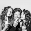 Stock Photo: Three women with middle finger send someone to hell