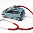 Stethoscope and car - Photo