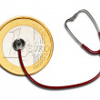 Royalty-Free Stock Photo: Euro coins and stethoscope