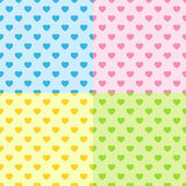 Four hearts seamless patterns — Stock Vector