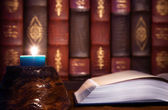 Antiquity - reading old books with candle light — Fotografia Stock