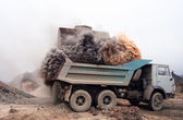 Dust explosion when loading truck at the mine — Stock Photo
