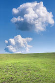Two clouds over mountain meadow — Stock Photo