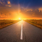 Driving on an empty road towards the setting sun 2 — Stock Photo