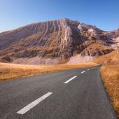 Driving on empty asphalt road — Stock Photo