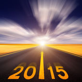 Motion blurred empty asphalt road forward to new year — Stock Photo