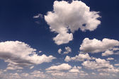 Background with clouds on a sunny day — Stock Photo