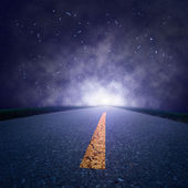 Driving on an empty road at night — Stock Photo