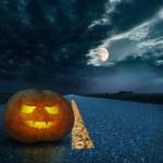 Halloween night background on the road — Stock Photo