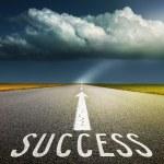 Empty asphalt road and signs symbolizing success — Stock Photo