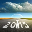Driving on an empty asphalt road  forward to new 2015 — Stock Photo #45825787