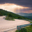Road with a sharp bend in the mountain — Stock Photo