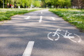 Bicycle lane with white bicycle sign — Stock Photo