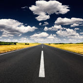 Driving on an empty asphalt road at sunny day — Stock Photo