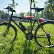 Bike on the green field — Stock Photo