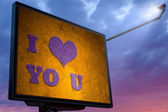 Billboard at sunset with a message I love you — Stock Photo