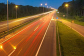 Long exposure photo on a highway with light trails — Stock Photo
