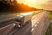 Blue truck in motion blur on the highway — Stock Photo