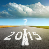 Driving on an empty asphalt road  forward to 2015 — Stock Photo