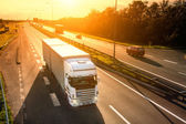 White truck in motion blur on the highway — Stock Photo