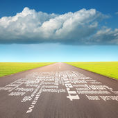 Empty road with word cloud at sunny day — Stock Photo