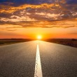 Driving on an empty road towards the sunset — Stock Photo #50720809