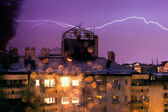 Horizontal lightning, night storm in the city — Stock Photo