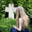 Stock Photo: Young girl at cemetery