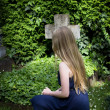 Young girl at the cemetery — Stock Photo