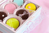 Colorful cookies in wooden box — Stock Photo