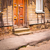 Entrance area of old wooden house — Stock Photo