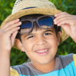 Boy with sunglasses and straw hat — Stock Photo