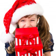 Cute girl holding gift boxes — Stock Photo