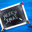 Blackboard decorated with colorful cookies — Stock Photo